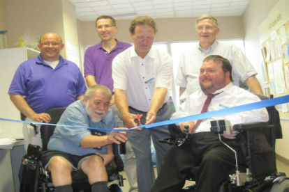 Dignitaries look on at KW AccessAbility's 40th anniversary ribbon cutting